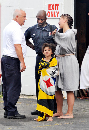 John P. Cleary   The Herald Bulletin<br /> Emily Nicole, along with her 5-year-old son, talk with the fire department after evacuating their home in the 900 block of Nichol Avenue after waking to the kitchen being on fire Thursday morning.