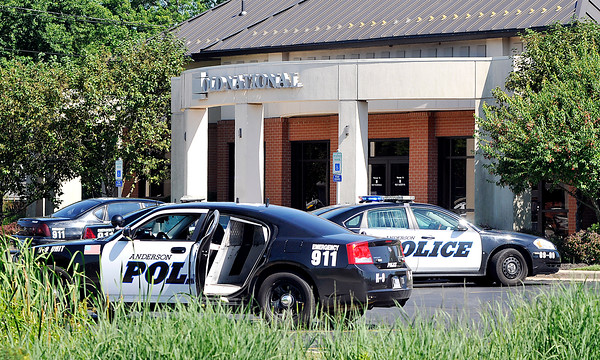 John P. Cleary   The Herald Bulletin<br /> APD on scene at Old National Bank at 219 S. Scatterfield Rd. were a robbery was reported Monday afternoon.