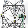 John P. Cleary | The Herald Bulletin<br /> Workers from MPX Solutions, of Anderson, lineup another section of the 350 foot radio tower they were erecting on Delaware Street Tuesday for the new Madison County radio system. The new system, with five towers, is scheduled to be completed by October to begin testing.
