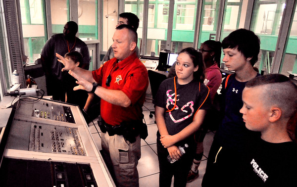John P. Cleary   The Herald Bulletin<br /> Kids from Indiana State Police's Law Camp tour Madison County Jail.