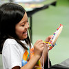 Don Knight | The Herald Bulletin<br /> Sophia Imafuji, 7, makes a dream catcher during an art camp at Anderson Center for the Arts on Thursday. The center's next summer camp runs from July 11th to the 14th.