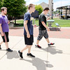 Don Knight | The Herald Bulletin<br /> From left, Riley Rankin, Tyler Toombs and Tylr Costa play Pokèmon GO in downtown Anderson on Friday.