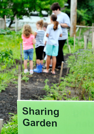 John P. Cleary | The Herald Bulletin<br /> Park Place Community Center has a kids gardening club where they learn and care for a plot in the center's community garden.