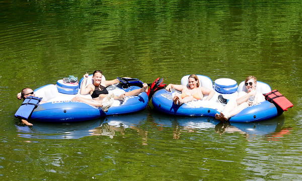 Don Knight | The Herald Bulletin<br /> This group keeps their cool in Friday's heat and humidity with a float down the White River.