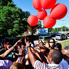 John P. Cleary | The Herald Bulletin<br /> People gather at the Martin Luther King Jr. statue for a prayer vigil for the recent shooting victims. They released seven balloons, one for each shooting victim that lost their lives this week, together to show solidarity.