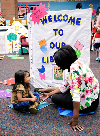 Don Knight   The Herald Bulletin<br /> Schneida Burgess talks to Serena Hurst in the library at the Killbuck Kindergarten Extension during meet the teacher night on Tuesday. Anderson students return to the classroom on Wednesday August 3rd.