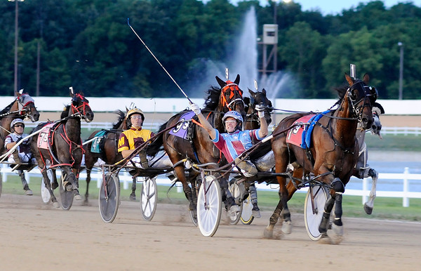 Don Knight | The Herald Bulletin<br /> Sam Widger reacts as he wins the ninth race with Stevie Scooter also winning  the first round of the All-Star Driver Series at Hoosier Park on Saturday.