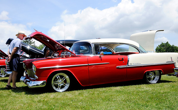 Don Knight   The Herald Bulletin<br /> Ron Mabrey looks at a '55 Chevy during Goodstock at Good's Candy Shop on Saturday. The annual event combines a car show and live music.