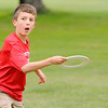 Don Knight | The Herald Bulletin<br /> Jacob Rust, 10, throws a flying ring to his dad Matt during the Edgewood Independence Day Celebration at the Edgewood Country Club on Saturday.