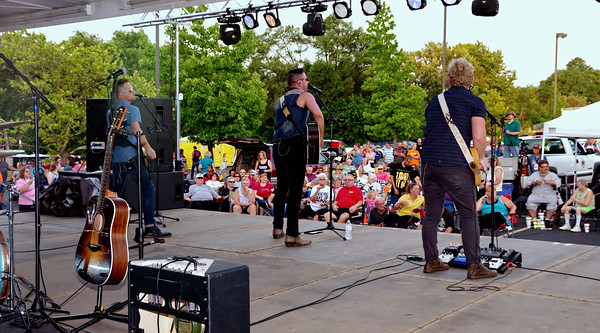 Singer-songwriter Corey Cox and his band entertain the crowd gathered for Anderson's Independence Day Celebration; their concert was followed by the rescheduled Fourth of July fireworks show.
