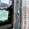 John P. Cleary | The Herald Bulletin<br /> City puts unsafe structure notice on building at 1500 W 2nd Street where part of roof caved in several weeks ago.