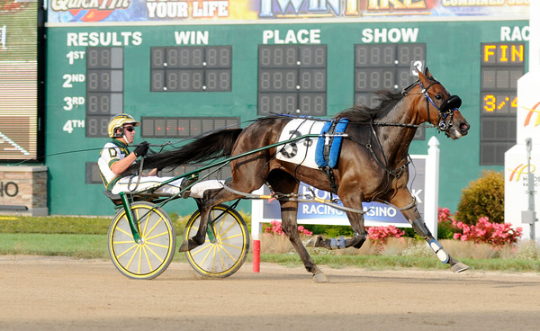 Don Knight | The Herald Bulletin<br /> John DeLong wins the first race of the All-Star Driver Series driving Skyway Billy at Hoosier Park on Saturday. DeLong finished second after the five races of the first round of the All-Star Driver Series.