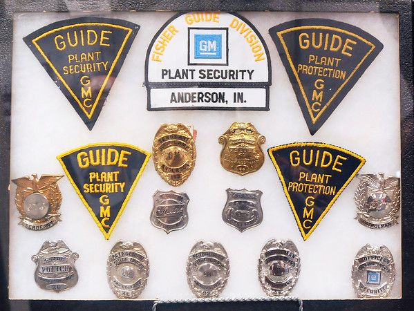 John P. Cleary   The Herald Bulletin<br /> New Guide Lamp exhibit at the Madison County Historical Society includes many plant security and police badges and patches.