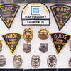 John P. Cleary | The Herald Bulletin<br /> New Guide Lamp exhibit at the Madison County Historical Society includes many plant security and police badges and patches.