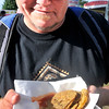 John P. Cleary | The Herald Bulletin<br /> Blake Vance, of Alexandria, lets his deep-fried green tomatoes cool before his digs in while at the Madison County 4-H Fair.