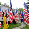 Don Knight | The Herald Bulletin<br /> Chris Swango and his fiance Fran Hall have a collection of 94 flags they display in front of their home on 29th Street on several national holidays each year. The two currently have 94 flags ranging from: colonial America, Civil War and the current Stars and Stripes.