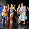 "Mark Maynard | for The Herald Bulletin<br /> Citizens of Oz celebrate the death of the Wicked Witch of the West in the opening number of the Alexandria Commons Theatre's youth production of ""Oz."""
