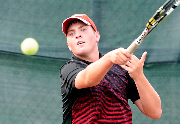 John P. Cleary |  The Herald Bulletin<br /> Conner Murphy follows his forehand return during Community Hospital Anderson Tennis Classic boys varsity singles match action Monday evening<br /> against Noah Wolfgang.