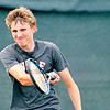 John P. Cleary |  The Herald Bulletin<br /> Seth Moore returns a shot during his boys varsity singles match against Trevor Simison Monday evening during Community Hospital Anderson Tennis Classic action.