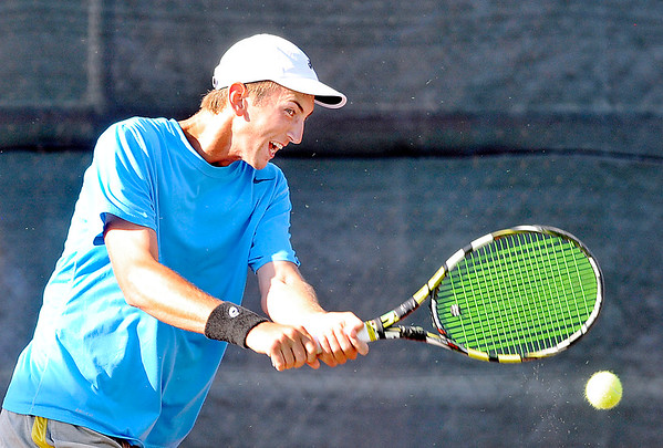 John P. Cleary    The Herald Bulletin<br /> Joseph Conrad hits a two-handed shot in the Men's A singles finals match against Garret Fensler Saturday evening at the Community Hospital Anderson Tennis Classic.