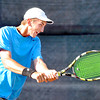 John P. Cleary |  The Herald Bulletin<br /> Joseph Conrad hits a two-handed shot in the Men's A singles finals match against Garret Fensler Saturday evening at the Community Hospital Anderson Tennis Classic.