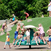 Don Knight | The Herald Bulletin<br /> Kids play on the the new playground equipment at Daleville's Town Hall Park on Wednesday.