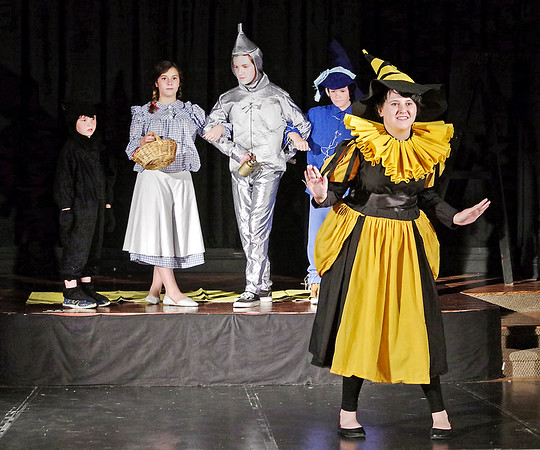 Mark Maynard | for The Herald Bulletin<br /> While Toto (Mason Hill), Dorothy (Hannah Whipple), the Tinman (Tyler McCorkle) and the Scarecrow (Elijah Bock) travel the yellow brick road, the Wicked Witch of the West lays out her scheme to avenge the death of the Wicked Witch of the East and reclaim the silver slippers from Dorothy.