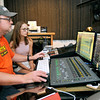 John P. Cleary |  The Herald Bulletin<br /> Gaither Studios engineer Chad Evans works with Orangehaus Music Business camp student Claire Radel, 17, from Maconaquah High School, in the mixing room as he works on the recordings that the camp students have made during their time at the studios.