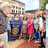 John P. Cleary |  The Herald Bulletin<br /> Rotary members celebrate their 100th anniversary around the Peace Pole in Dickmann Town Center Wednesday. Heading up the group is Bob Shoemaker, front left, who is the oldest living member of the Anderson club. Shoemaker, 95, joined the Rotary Club in 1948.