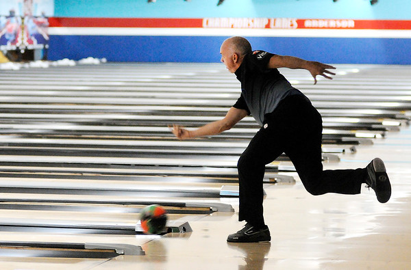 Don Knight   The Herald Bulletin<br /> Former major league pitcher John Burkett practices at Dave Small's Championship Lanes in Anderson on Saturday. Burkett is competing in the PBA50 event this week at Dave Small's Championship Lanes.