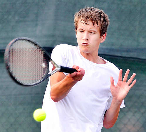 John P. Cleary    The Herald Bulletin<br /> Noah Wolfgang returns a shot during his boys varsity singles match against Conner Murphy Monday evening during Community Hospital Anderson Tennis Classic action.