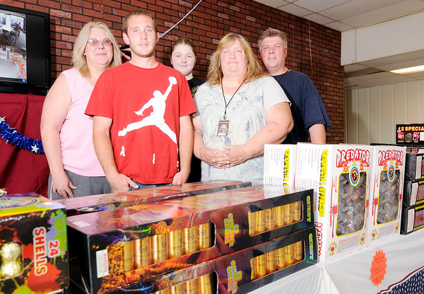 Don Knight | The Herald Bulletin<br /> Ryan Peter opened a fireworks shop for the first time this year with the help of his family. From left are Judy Dewitt, Ryan Peter, Trinity Dewitt, Rhonda Peter and Ron Miller.