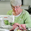 John P. Cleary |  The Herald Bulletin<br /> Virginia Reitmayer sews the cutout pieces together to make the body of the Love Bears.