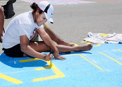 Don Knight | The Herald Bulletin Anderson High School senior Hailey Sargent, 17, paints her parking space on Tuesday. The first day of school for Anderson Community Schools is August 2nd.