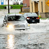 Don Knight | The Herald Bulletin<br /> Cars drive through the flooded intersection of Fletcher and 29th Streets after storms moved through on Friday.
