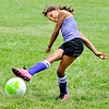 John P. Cleary |  The Herald Bulletin<br /> Shaela Francis, 9, from Pendleton, lets her kick go toward the goal as she runs through drills at the Anderson University Soccer Camp Monday afternoon. About 130 kids from ages 8-18 are on campus for the five-day camp to help them hone their soccer skills.