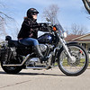 John P. Cleary | The Herald Bulletin<br /> Summer Greenlee takes advantage of the warm Christmas temperatures to get the motorcycle out for a ride with her husband Todd.