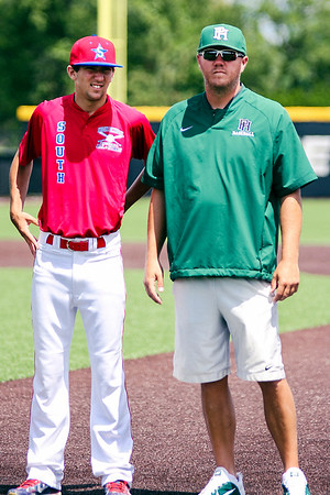Chris Martin for The Herald Bulletin<br /> Pendleton pitcher Eston Stull is accompanied by Pendleton Height's coach Travis Keesling during pregame introductions at the North vs South Indiana High School All Star game Saturday at Ball State.