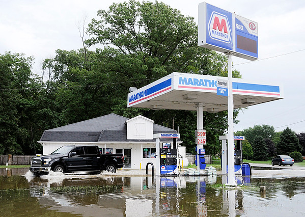 Don Knight   The Herald Bulletin<br /> The Marathon station at Indiana 67 and County Road 100 South was flooded after heavy rain on Thursday.