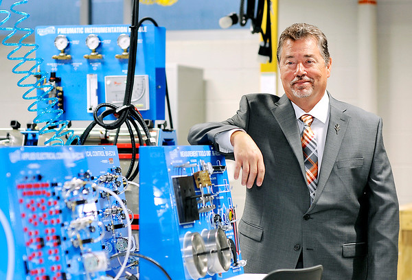 John P. Cleary    The Herald Bulletin<br /> Dr. James Willey is transitioning from president to chancellor of Ivy Tech Community College's Anderson campus as part of the school's restructuring. Shown here in the Advance Automation Robotics Technology area, Willey wants the curriculum to better reflect the skills needed by Madison County employers.