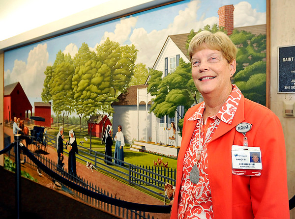 John P. Cleary    The Herald Bulletin<br /> Nancy Pitcock, vice president and chief nursing officer for St. Vincent Anderson, is retiring after 46 years of service at the hospital. Nancy is shown here in front of the lobby mural that recognizes the benefactors and founders of Anderson's first hospital.