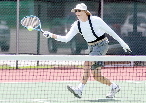 Don Knight   The Herald Bulletin<br /> Phill Reismiller returns a volley as he and Dick Robinette play Don Eckstein and Don Volk in a Men's 65 Doubles match during the Community Hospital Anderson Tennis Classic on Saturday.