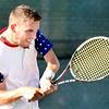 John P. Cleary |  The Herald Bulletin<br /> Garrett Fensler returns a shot during his Men's A singles finals match against Joseph Conrad.