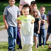 "Don Knight | The Herald Bulletin<br /> Kase Powell, 6, takes part in a sack race during vacation Bible school ""Down on the Farm"" at First Missionary Baptist Church in Elwood."