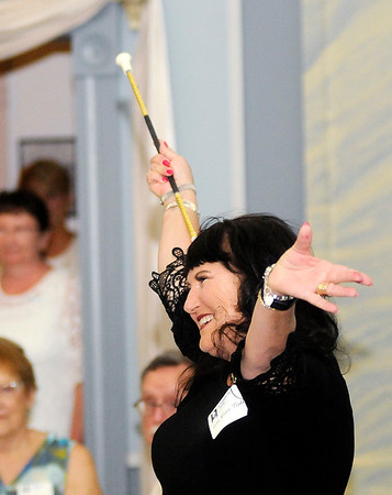 Don Knight | The Herald Bulletin<br /> Lisa Ross Todd introduces herself during the Elwood Twirlers reunion to recognize Tudy Smith at the Elwood Opera House on Saturday.Todd was Purdue's Gilr-in-Black from '74 to '79 and a twirler for the Detroit Lions in 1980.