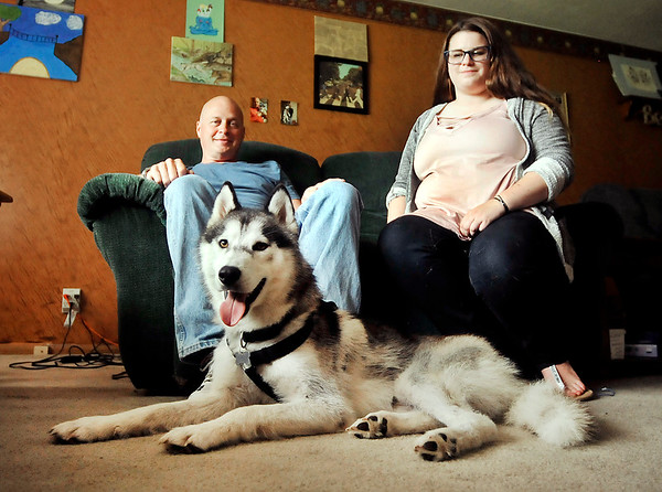 John P. Cleary    The Herald Bulletin<br /> David Beach and his daughter Myranda watch Lobo rest on the floor on their southside Anderson home. The Siberian husky was missing for 11 days after David and Myranda's kayaks capsized while going down White River with Lobo and he was not rescued.