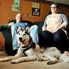 John P. Cleary |  The Herald Bulletin<br /> David Beach and his daughter Myranda watch Lobo rest on the floor on their southside Anderson home. The Siberian husky was missing for 11 days after David and Myranda's kayaks capsized while going down White River with Lobo and he was not rescued.