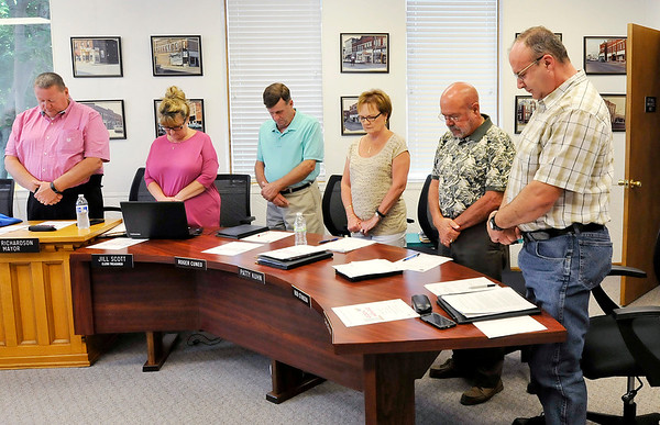 John P. Cleary |  The Herald Bulletin<br /> The Alexandria City Council bows their head for a prayer following the pledge of allegiance during their meeting on Monday.