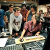 John P. Cleary |  The Herald Bulletin<br /> Orangehaus Music Business camp student Noah McCullough, 18, front left, talks with producer Stephen Potaczek as he plays back the mastered version of Noah's song he recorded Thursday at Gaither Studios as other students watch in the background. McCullough is a senior at Perry Meridian High School in Indianapolis.