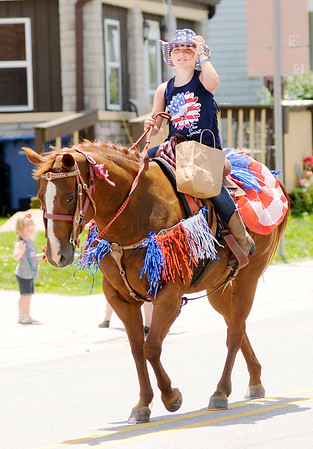 Don Knight | The Herald Bulletin<br /> A horse and rider decorated for the Fourth of July holiday weekend participates in Summitville's 2nd annual Firecraker Festival parade on Saturday.